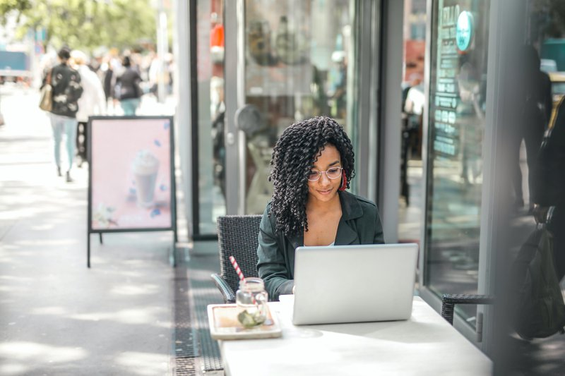 Person working on blogger outreach on a laptop