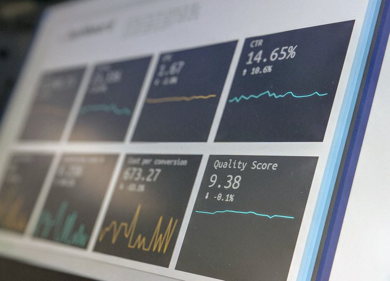 Data reporting dashboard on a laptop screen.